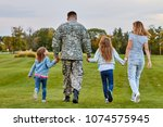 back view soldier's family... | Shutterstock . vector #1074575945