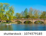 people are passing river avon... | Shutterstock . vector #1074579185