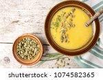pumpkin cream soup  sprinkled... | Shutterstock . vector #1074582365