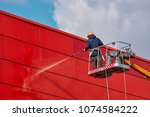 worker wearing safety harness... | Shutterstock . vector #1074584222