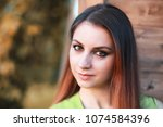 beautiful girl with red hair     Shutterstock . vector #1074584396