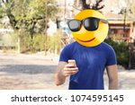 emoji head man using a... | Shutterstock . vector #1074595145