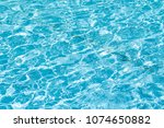 water in the pool of blue... | Shutterstock . vector #1074650882