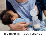 busy mother pump milk into... | Shutterstock . vector #1074652436