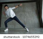 teenager guy in white sweater... | Shutterstock . vector #1074655292