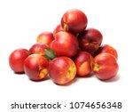 ripe peach on white background | Shutterstock . vector #1074656348