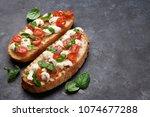 caprese bruschetta toasts with...   Shutterstock . vector #1074677288