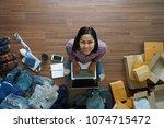 top view of women working... | Shutterstock . vector #1074715472
