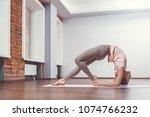 young girl doing yoga in yoga... | Shutterstock . vector #1074766232