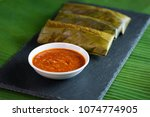 sticky rice wrapped in leaves... | Shutterstock . vector #1074774905