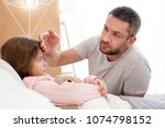 parental care. serious devoted... | Shutterstock . vector #1074798152