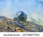 sulphur gas coming out of the... | Shutterstock . vector #1074807542