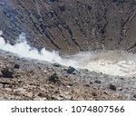 sulphur gas coming out of the... | Shutterstock . vector #1074807566