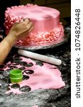 decorating a cake pink icing... | Shutterstock . vector #1074826448