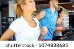 picture of people running on... | Shutterstock . vector #1074838685