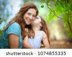 portrait of a cute little girl... | Shutterstock . vector #1074855335