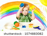 baby modeling colorful clay ... | Shutterstock . vector #1074883082