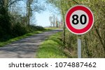 a limit speed at 80 km h on the ... | Shutterstock . vector #1074887462