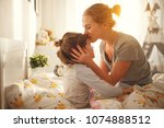 morning awakening. mother wakes ... | Shutterstock . vector #1074888512