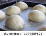 raw unbaked buns. ready to bake ...   Shutterstock . vector #1074889628