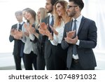 group of business people... | Shutterstock . vector #1074891032