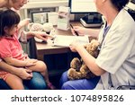 young patient is getting a... | Shutterstock . vector #1074895826
