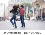 lovely couple dancing west... | Shutterstock . vector #1074897092