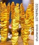 fried spiral potato street fast ... | Shutterstock . vector #1074898232