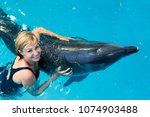 coach swims in the water with... | Shutterstock . vector #1074903488