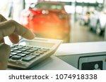 man pressing calculator for... | Shutterstock . vector #1074918338