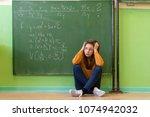 teenager girl in math class... | Shutterstock . vector #1074942032