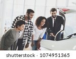 african american family at car... | Shutterstock . vector #1074951365