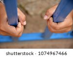 human hands are trapped in the... | Shutterstock . vector #1074967466