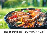 grilled sausage on the picnic... | Shutterstock . vector #1074974465