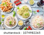 several plates of pasta with... | Shutterstock . vector #1074982265