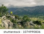 hiking man looking at beautiful ... | Shutterstock . vector #1074990836