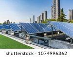 solar and modern city skyline  | Shutterstock . vector #1074996362