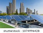 solar and modern city skyline  | Shutterstock . vector #1074996428