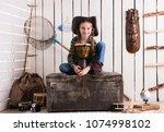 beautiful little girl in cowboy ...   Shutterstock . vector #1074998102