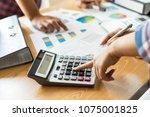 close up hand of business... | Shutterstock . vector #1075001825