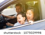 happy asian family is smiling... | Shutterstock . vector #1075029998