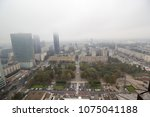 european city in in fog and smog | Shutterstock . vector #1075041188