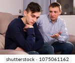 adult man is asking forgiveness ... | Shutterstock . vector #1075061162