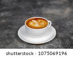 the hot coffee art in the white ... | Shutterstock . vector #1075069196