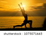 silhouette of woman practicing... | Shutterstock . vector #1075071665