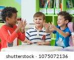 group of diversity kids boy sit ... | Shutterstock . vector #1075072136