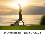 asia woman making yoga in... | Shutterstock . vector #1075072175