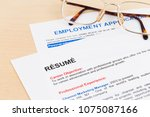 Small photo of Resume and employment application form with glasses