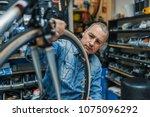 repair technician bicycles was... | Shutterstock . vector #1075096292