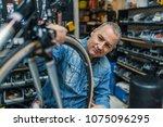 repair technician bicycles was... | Shutterstock . vector #1075096295